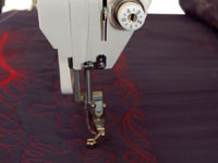 Queen Quilter Eighteen Needle Positioner.