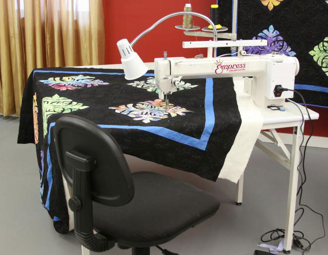 Tin Lizzie Empress Sit Down with Table. Check Out Handi Quilter Sweet Sixtween Long Arm Below!