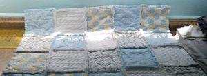 Soft baby blue rag quilt.