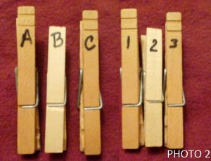 First, use a marker or pen to label the clothespins based on the labels found on the pattern pieces or the pattern guide.