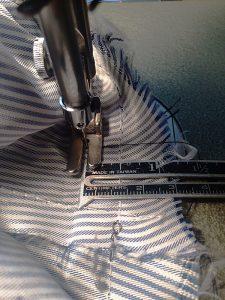 Sew new stitching line shortening hem.