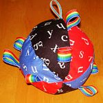 For babies, try a stuffed ball with ribbon tags for grabbing.