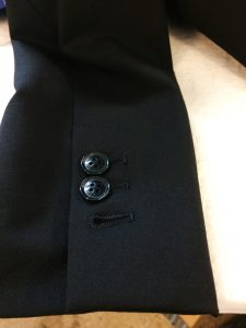 Functional, cut buttonhole, unless you need to lengthen the sleeve.