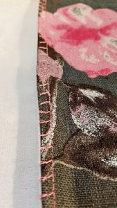The left side is machine stitched with an Overcast stitch. The right side is hand stitched. Both have no raw edges showing on either side.