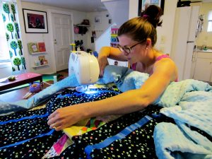 Machine quilting with a walking foot. Image via charlottekaufman.com.