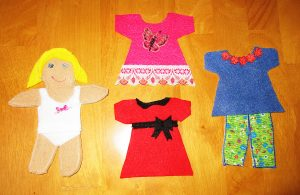 "Felt sticks to felt and works perfectly for making ""paper"" dolls."