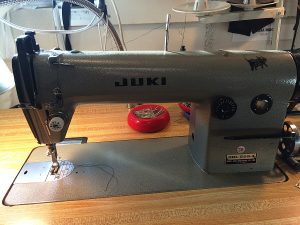 I sew most often on my industrial Juki straight stitch machine and it doesn't have a free arm.