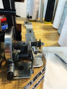 You'll need to engage the bobbin by pushing it backwards so that the wheel connects with the belt of the machine.