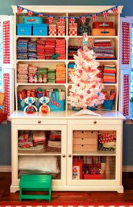 This hutch makes a wonderful storage area for fabric, and other than price & space, I wouldn't hesitate to have one of these in my home.