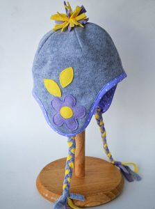 Delia shows how to embellish a simple ear warmer headband with a huge fleece flower.