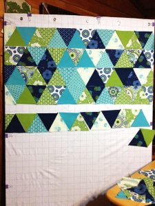 Start pinning & planning, shifting around your fabric blocks until everything fits in a way you're comfortable with!