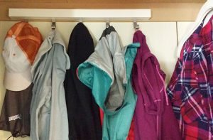 The gray hoodie is on the left & the maroon jacket is on the right.