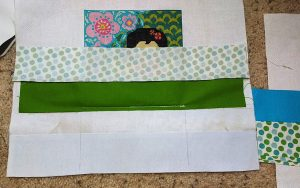 I only stitched around the actual cross stitching, leaving the rest of the fabric loose on all four sides like this.