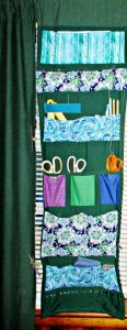 My sewing room curtain organizer panels use all of the above kinds of pockets.