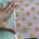 Here I folded the cotton fabric seam over the minky fabric and then placed a scrap of fabric over both.