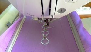 Embroidery patterns are easily downloaded to a USB, which then plugs directly into the left-hand side of the machine.