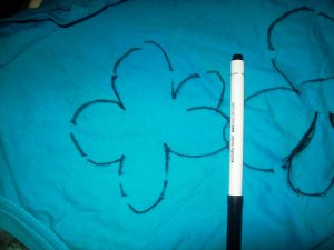 Take a marker (use a fabric-friendly writing utensil!) & trace the patterns of flowers, butterflies, clouds, the sun, a house…