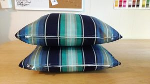 Two puffy pillow cases with zippered closes that are the same front & back.