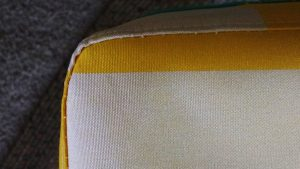 Flipped over & on the table, you can see how much more snugly the tablecloth fits because of the topstitching.