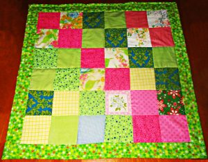 Baylee quilt, caption, I made this quick scrap quilt in only about an hour & a half.