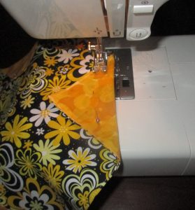 "Place the folded edge at the 5/8"" mark on your machine, and sew straight across."