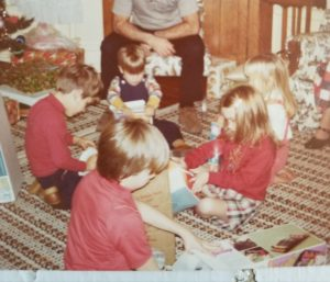 The Christmas Tree Turtleneck. Not a great photo of it but the only one I could find. Note that my brother (sitting across from me) is wearing a turtleneck in the same color.